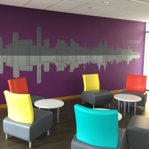 Break room with coloured chairs and tables